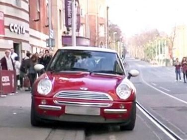 mini parked on sidewalk